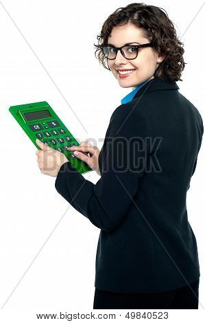 Young Businesswoman Using Calculator