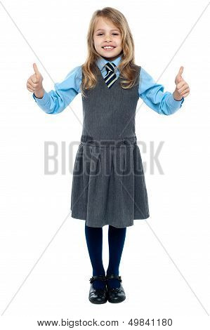 Pretty School Child Showing Thumbs Up Gesture