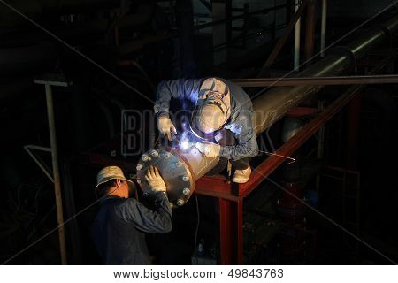 Welder Uses Torch To Make Sparks