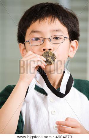 Winning Boy Kissing Medal