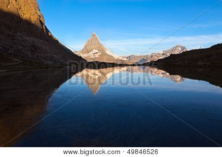Matterhorn reflecton in Riffelsee after sunset, Zermatt, Alps Switzerland