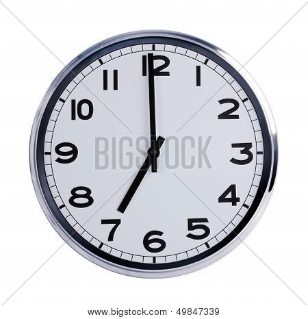 Round Office Clock Shows Seven O'clock