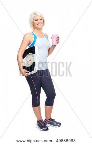 weightloss woman with scale showing diet and exercise concept