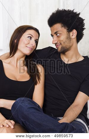 Young cheerful interracial couple