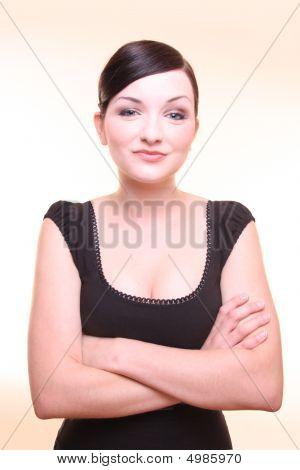 Beautiful Businesswoman With Arms Crossed On A Light Background