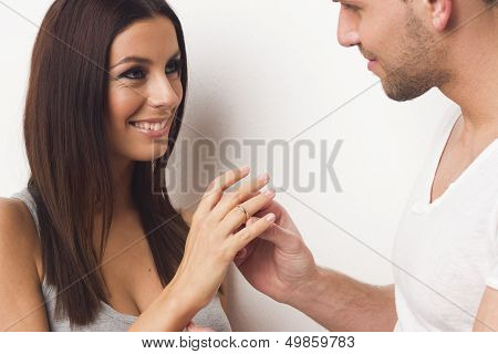 Young caucasian couple with engagement ring