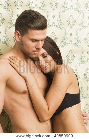 Sexy passionate heterosexual couple embracing