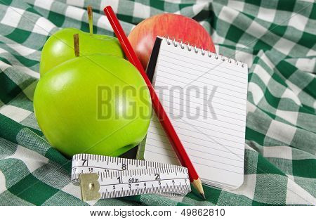 note pad and apples