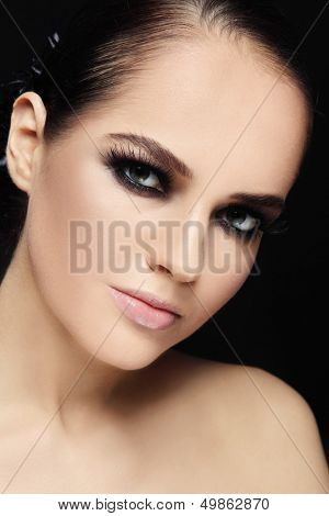 Portrait of beautiful stylish young woman with smokey eyes