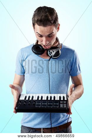 Deejay With Headphones Holding Midi Keyboard In Hands