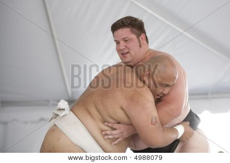 Sumo Wrestlers Grappling