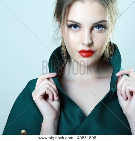 fashion girl, portrait of young glamour luxury fashionable woman looking at camera, toned