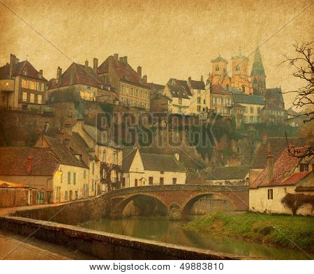 Semur-en-Auxois. Burgundy, France. Photo in retro style. Paper texture.