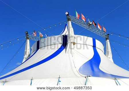 Circus big top tent in blue and white.