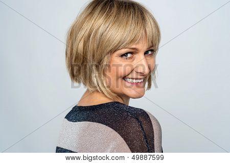 Flirtatious Lady Turning Back And Smiling