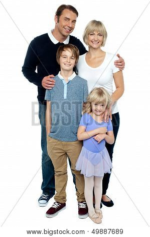 Indoor Studio Shot Of Lovely Family, Four Members