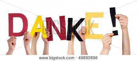 Hands Holding Danke In German Colors