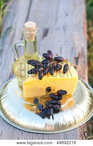Olive Oil In The Jug, Cheese, Dark Blue Grapes