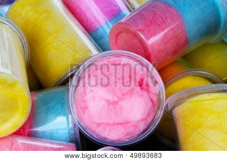 Colorful cotton candy in plastic cups