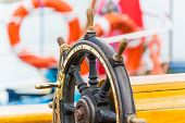 stock photo of historical ship  - Macro view of wooden steering wheel on sailing ship - JPG