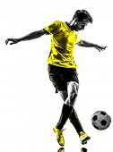 one brazilian soccer football player young man dribbling in silhouette