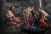 stock photo of karts  - Girls at a garage next to the Go - JPG