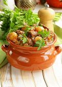 stock photo of boeuf  - Beef stew with vegetables and herbs in a clay pot  - JPG