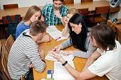 stock photo of classmates  - group of student studying together - JPG