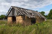 picture of shacks  - Dilapidated old farm shack in a field - JPG