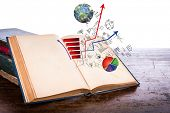 Open old vintage book with business graph  on wooden table  (Elements of this image furnished by NAS poster