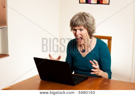 Stressed senior computer user