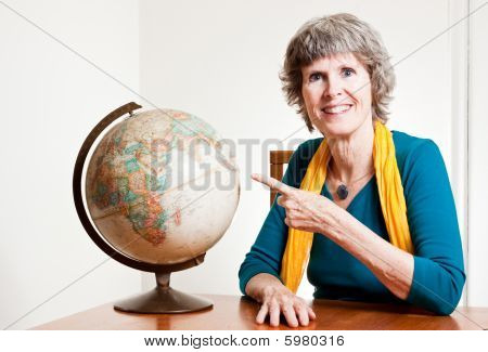 Senior lady planning her retirement travel