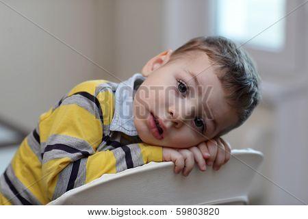 Portrait Of Boy At Highchair