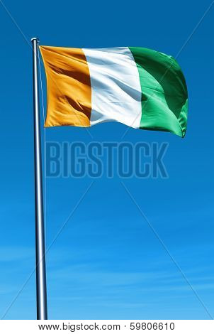 Cote dIvoire flag waving in the evening