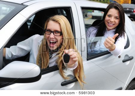 Car Rental: Women Driving A New Car