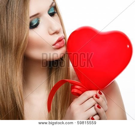 Beautiful blonde kissing heart