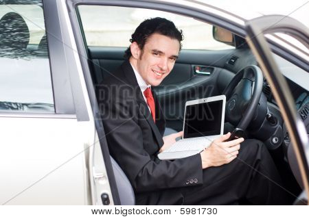 business man inside a car