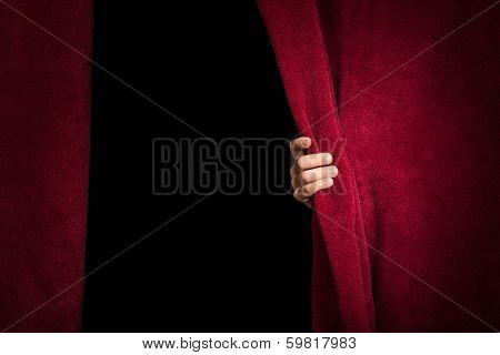 Hand Appearing Beneath The Curtain.