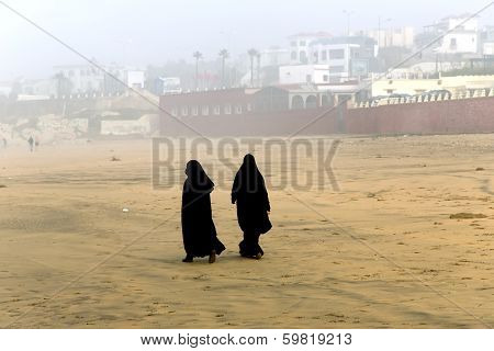 Two Arabic women are in a yashmak