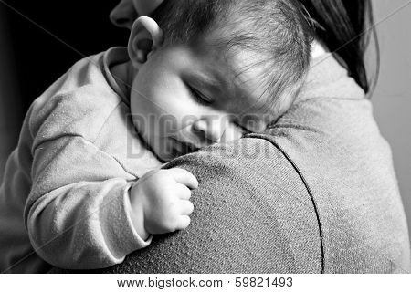 Little Baby girl sleeping in mothers arms - Lifestyle black and white