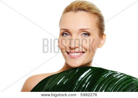 Woman With Clean Health Skin  And Fresh Leaf Covering Her Body