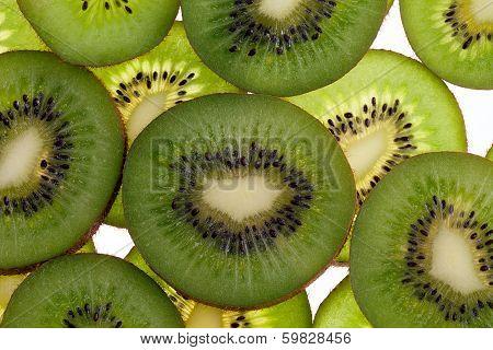 slices of fresh green fruit kiwi isolated on white background