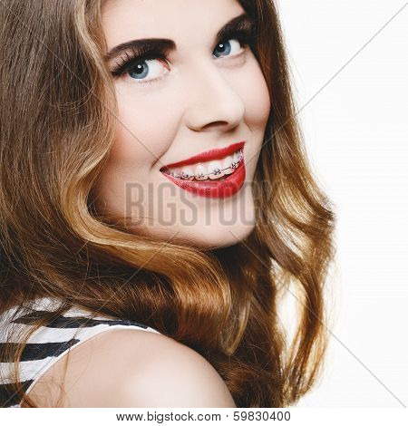 Beautiful woman smiling with braces