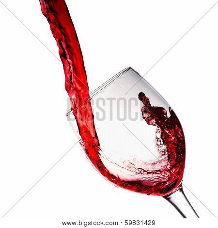 Red wine poured into wine glass
