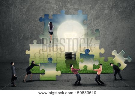 Business Team Creating A Puzzle