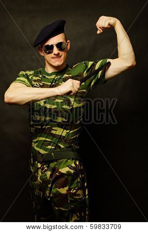 Young military man with nightstick