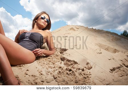 Young slim woman on beach portrait.