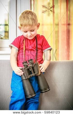 Portrait Of Happy Boy Child Kid Playing With Binoculars. At Home.