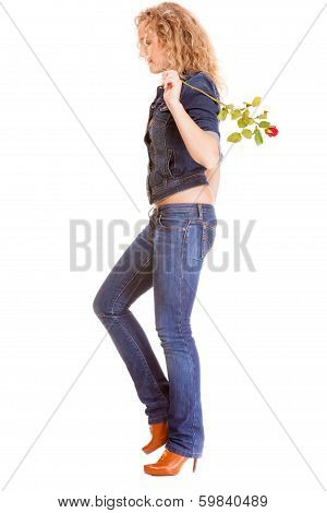 Denim Fashion. Full Length Blonde Girl In Blue Jeans With Red Rose