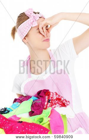 A picture of a young woman holding stinky laundry over white background